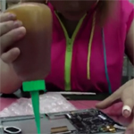 Girl working in electronics factory