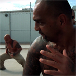 Hawaiian prison inmates practicing their native dances