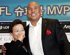 multiracial football player with his mom