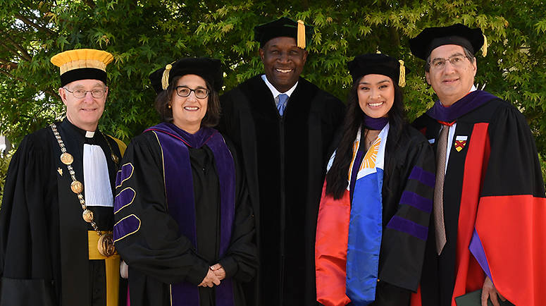 (From left) Rev. Paul J. Fitzgerald, S.J., Associate Dean for Academic Affairs Susan Freiwald, Hon. Martin J. Jenkins '80, Elise Giongco '18, and Dean John Trasviña