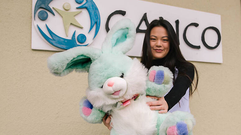 Ally Loo '22 in front of CALICO with her stuffed rabbit