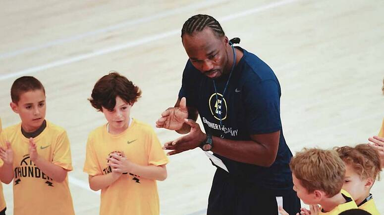 Jerome Gumbs works with kids in the Empower Me Academy