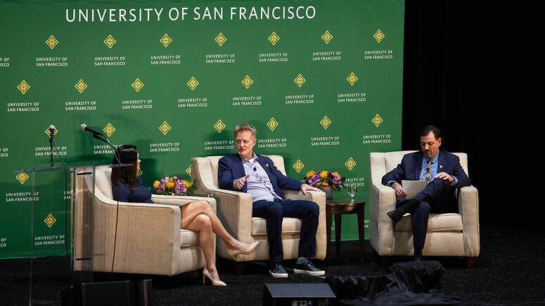Steve Kerr in conversation with two moderators
