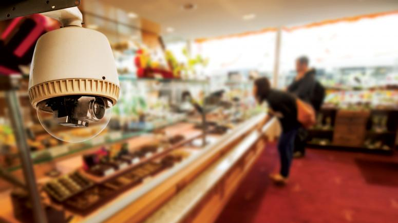Surveillance camera in a store with shoppers