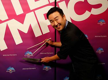 Alexander Hwang poses with cooking utensils