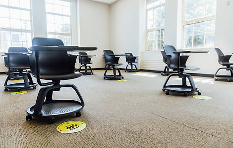 Classroom with 6-foot social distancing stickers on the floor