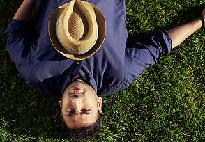 Paresh Ravikuman lying down with hat on chest