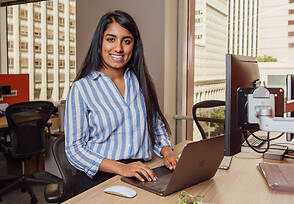 Chelsy at her desk during her software engineering internship with Mastercard