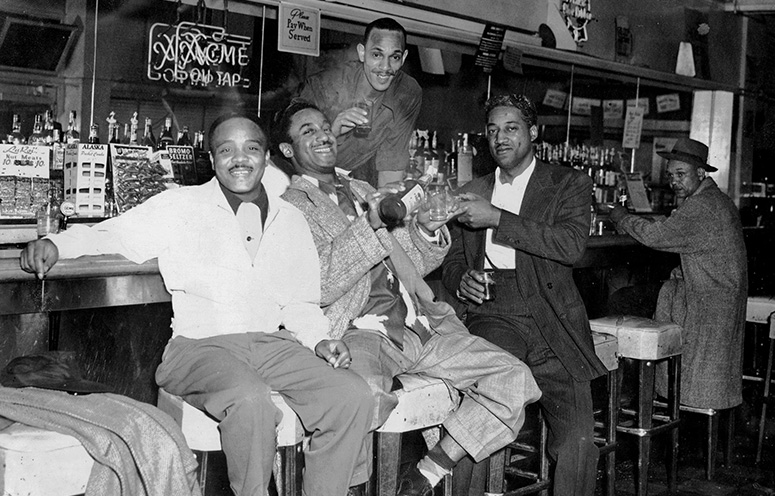 Historical image of a group seated at Fillmore bar